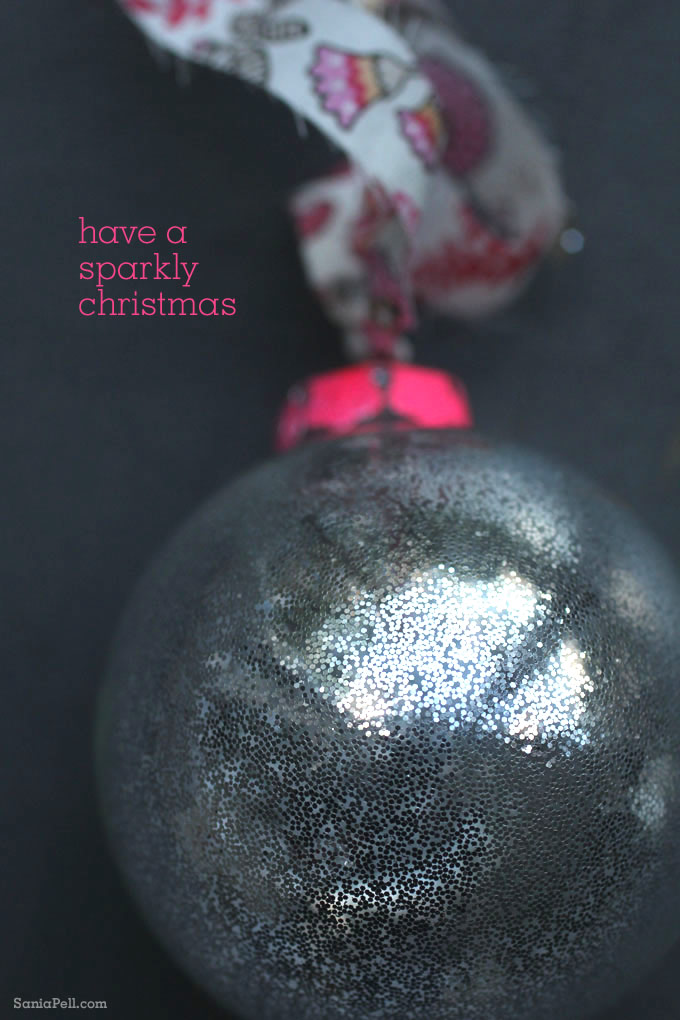 Pink neon and glitter Christmas bauble by Sania Pell